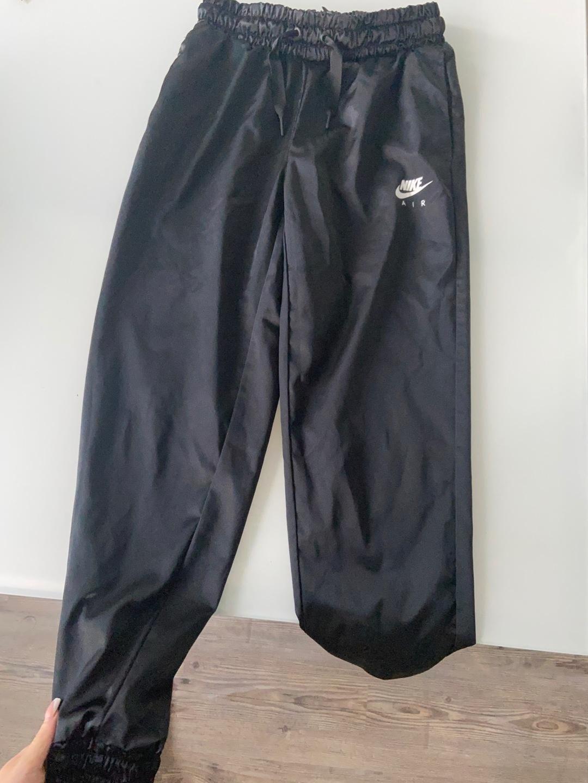 Women's trousers & jeans - NIKE photo 3