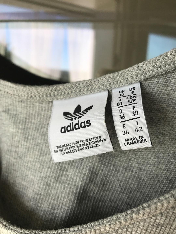 Naiset topit & t-paidat - ADIDAS photo 3