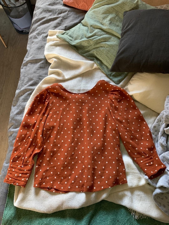 Women's blouses & shirts - BERSHKA photo 1