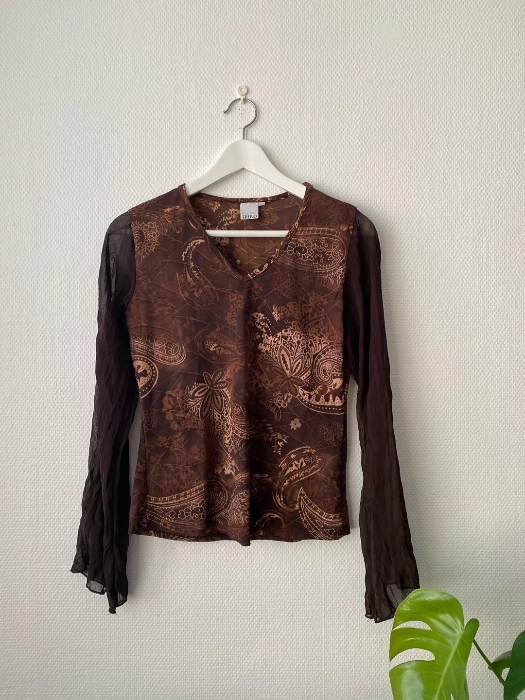 Women's blouses & shirts - TREND photo 1